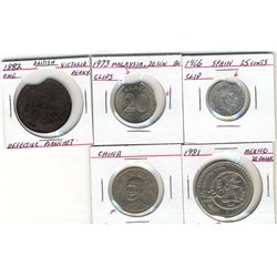 World Error coinage.  Includes four coins with clips from, Great Britain, Mexico, Spain, Malaysia an