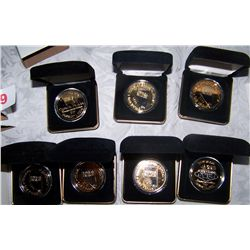 (7X$) VIP COMMEMORATIVE NEW YEARS COINS W/ SERIAL NUMBERS & GEMS
