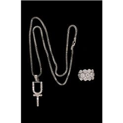 PENDANT & CHAIN: (1) Ladies diamond and 10k (stamped) white gold pendant and chain. Pendant is set w