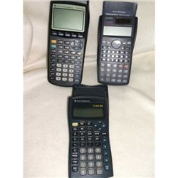 3-hand held calculators in case