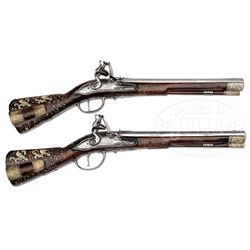 VERY FINE PAIR OF 17TH CENTURY GERMANIC GUN BUTT FLINTLOCK PISTOLS.