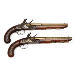 PAIR OF H. W. MORTIMER (LONDON) BRASS MOUNTED FLINTLOCK PISTOLS.
