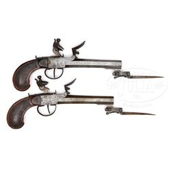 PAIR OF BELGIAN FLINTLOCK BOXLOCK PISTOLS WITH SPRING-LOADED BAYONETS.