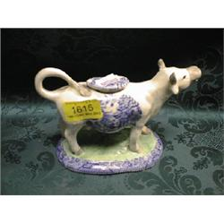 A Victorian Staffordshire cow creamer with blue and white ...