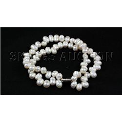 149.10CTW 7in. WHITE TWISTED RICE PEARL BRACELET