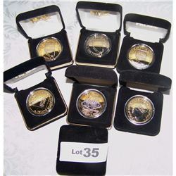 (7X$) NEVADA PALACE GOLD LAYERED COMMEMORATIVE COINS