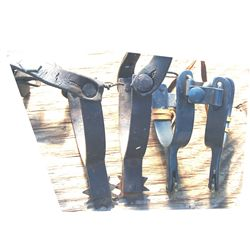 2 pairs of iron spurs