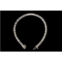 BRACELET: Lady's platinum diamond link bracelet; 25 sq prin dias, 2.5mm - 2.7mm = est 2.50cttw, Good