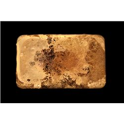 SCRAP: 530.45 gram bar of approximately 12kt gold; non-commercial slag bar; probable variant in puri