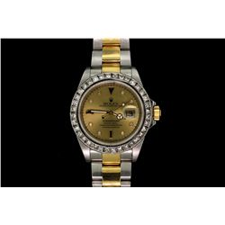 ROLEX: Men's st.steel & 18ky Rolex O.P. Submariner Date wristwatch w/ aftermarket diamond bezel; fac