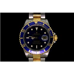 WATCH: [1] Stainless steel and 18KYG gents Rolex Submariner Oyster Perpetual Date watch with a blue