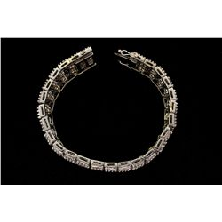 BRACELET:  [1] 18KWG bracelet set with rd and baguette diamonds, approx. 8.75cttw, J, fair-poor / SI