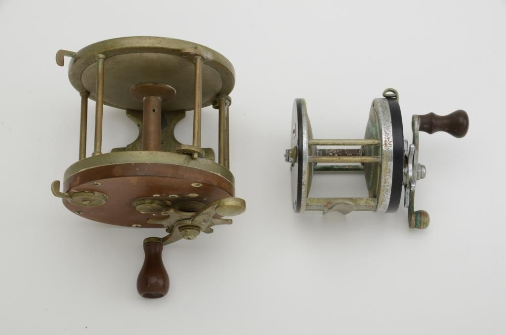 Two old fishing reels including a pflueger capitol no for Antique fishing reels