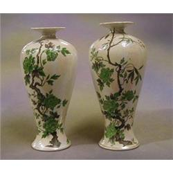 A pair of Shelley pottery vases decorated Oriental Tree, the base marked Shelley England 8048262,...
