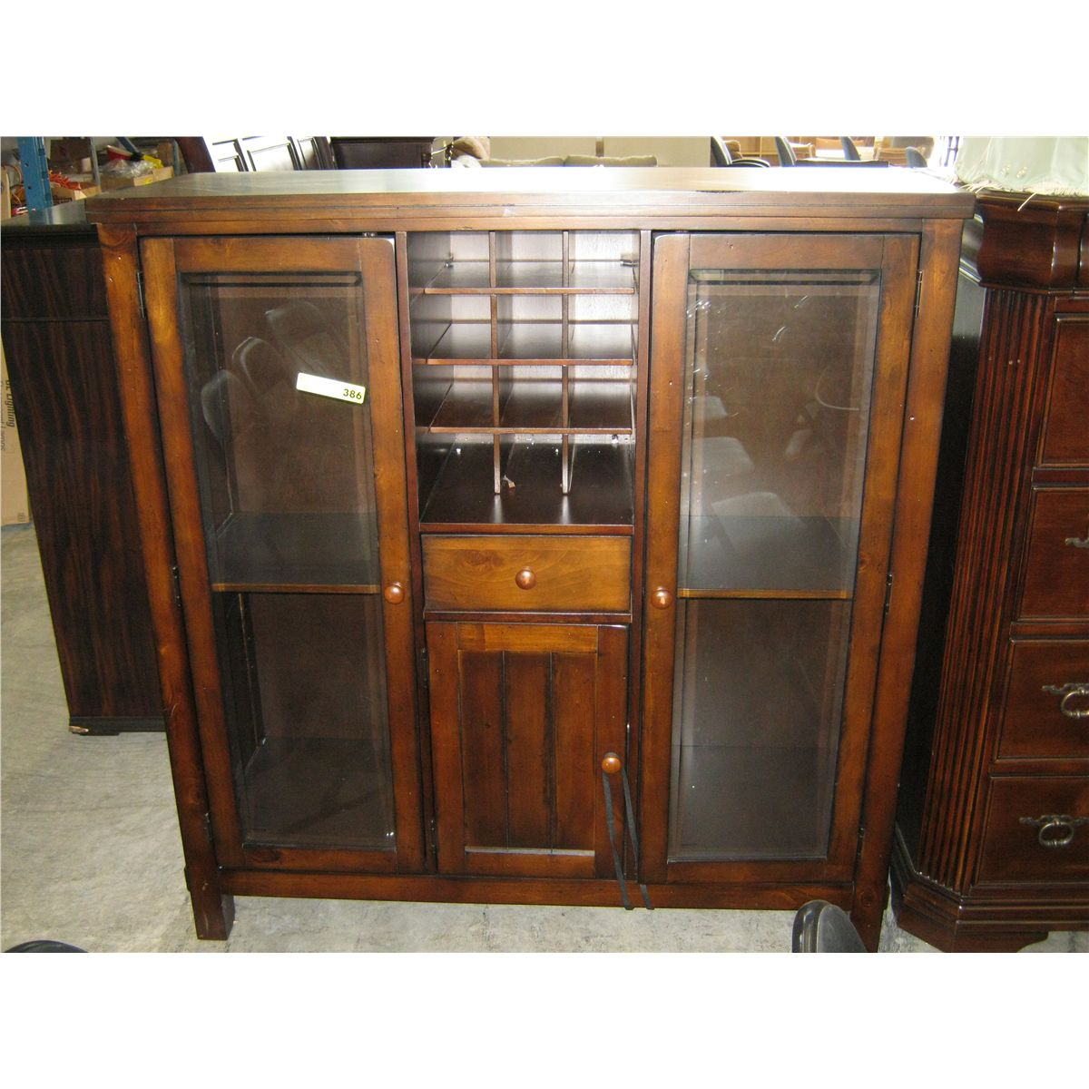 Cabinet with a built in wine rack & glass doors