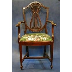 A set of 8 Edwardian mahogany Hepplewhite style dining chairs with lyre shaped pierced splat back...