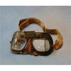 A pair of WWII Air Ministry flying goggles, marked AM220/826 2023 £50-75...