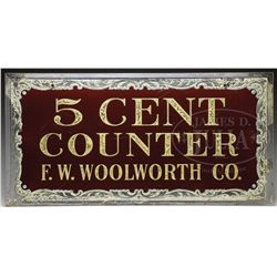 F.W. WOOLWORTH CO. REVERSE ON GLASS 5 CENT COUNTER SIGN.