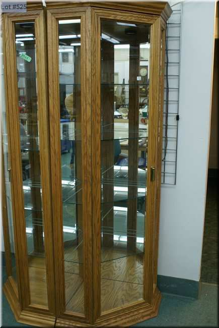 A Modern Oak Four Tier Illuminated Corner Display Cabinet With