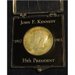 1311. 1917-1963 John F. Kennedy 35th President Snap Case with 1964 D Silver Half Dollar.