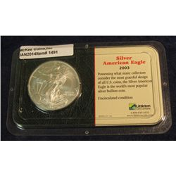 1491. 2003 American Eagle Silver Dollar In a Littleton Coin Co. holder. One ounce .999 fine Silver.
