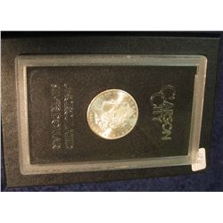 1592. 1884 CC Morgan Silver Dollar in original black box of issue with official card. MS 64/65.