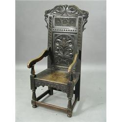 A 17th Century Style Oak Wainscot Chair Est. 150/250.