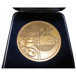 XIVth Commonwealth Games, Auckland, New Zealand, 1990 medal in case of origin, about 2 inches and co