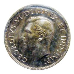 25 cents 1947 ICCS SP-64; Maple Leaf. Pretty toning and incredible lustre.
