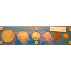 RCM Lot; 1953 Year set in Canada Mint Set hard casing, all NSF except the 25 Cents that is SF. Coins