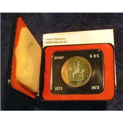 "92. 1873-1973 ""Mounted Police"" Canada Silver Prooflike Dollar. In original Royal Canadian Mint felt-"