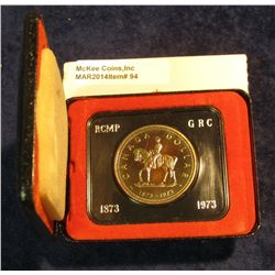 "94. 1873-1973 ""Mounted Police"" Canada Silver Prooflike Dollar. In original Royal Canadian Mint felt-"