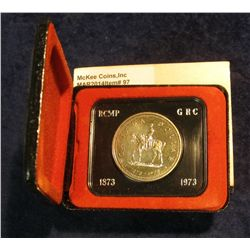 "97. 1873-1973 ""Mounted Police"" Canada Silver Prooflike Dollar. In original Royal Canadian Mint felt-"