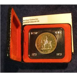 "98. 1873-1973 ""Mounted Police"" Canada Silver Prooflike Dollar. In original Royal Canadian Mint felt-"