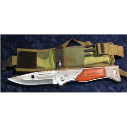 904.  Russian issued bayonet for AK47 – switchblade style, clips on over barrel end, in camo-st