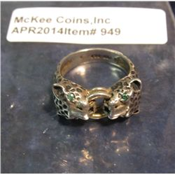 949.  Vintage silver ring with two opposing cheetahs / leopard heads bighting two stacked rings