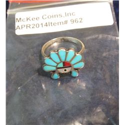 962.       Vintage silver and turquoise ring – made to resemble a head dress – marked STERLING
