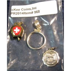 968.       3 silver charms – St. Augustine, FL disc style charm, a bezel for a 1/10th ounce silver r