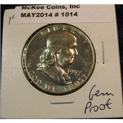 1014. 1957 P Franklin Half Dollar. Proof 64 with a superb Cameo frosted reverse.