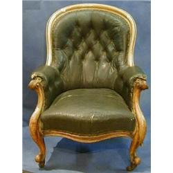 A Victorian bleached mahogany show frame tub back armchair upholstered brown buttoned rexine and...