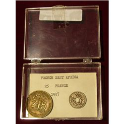 935. Plastic case with 1957 French East Africa 25 Francs Coin & 1921 France 5 Centimes.
