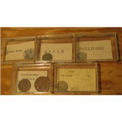 941. (5) Plastic cases with various Foreign Coins.
