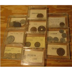 942. (10) Plastic cases with various Foreign Coins.