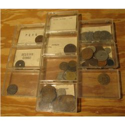 943. (10) Plastic cases with various Foreign Coins.
