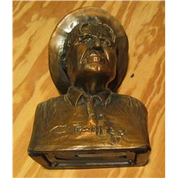 "1074. Bronze Bank of a C.M. Russell Sculpture advertising the ""Northern Bank of Montana, Big Sandy,"