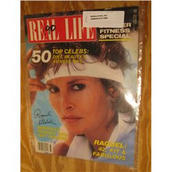 "1099. ""Real Life"" Magazine cover autographed by Raquel Welch."