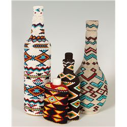 Four Paiute Bead Covered Bottles