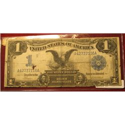 """464. Series 1899 U.S. One Dollar """"Black Eagle"""" Silver Certificate. Small hole left center, edges a l"""