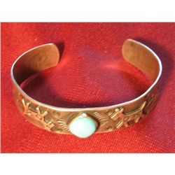 801. Silver and turquoise bangle style bracelet, has deer and Native American hieroglyphics, marked