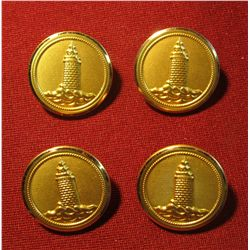 "807. 4 old brass BU ttons with lighthouses, marked ""WATERBURY BUTTON CT USA"""
